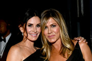 Courteney Cox (L) and Jennifer Aniston attend the American Film Institute's 46th Life Achievement Award Gala Tribute to George Clooney at Dolby Theatre  on June 7, 2018 in Hollywood, California.  390073