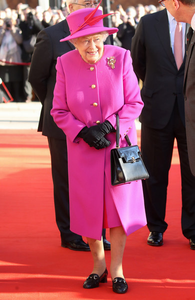 Everyone Keeps An Eye On The Queen's Purse