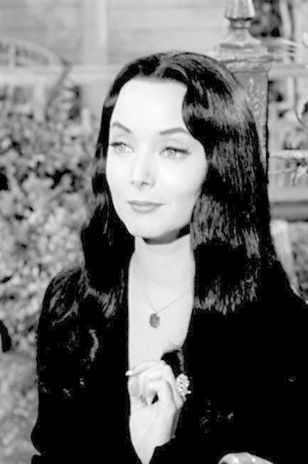 Cutting roses addams family morticia Addams Family
